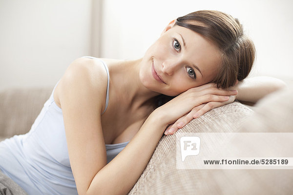 Portrait of young Woman on sofa