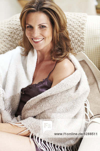 Mature Woman relaxing on Stuhl