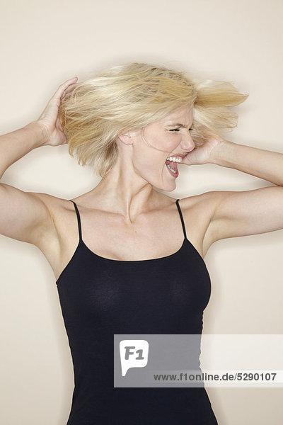 Studio shot of beautiful mature blonde woman