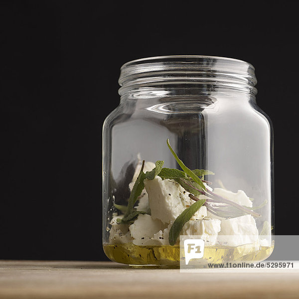 Feta marinating in herbs and olive oil