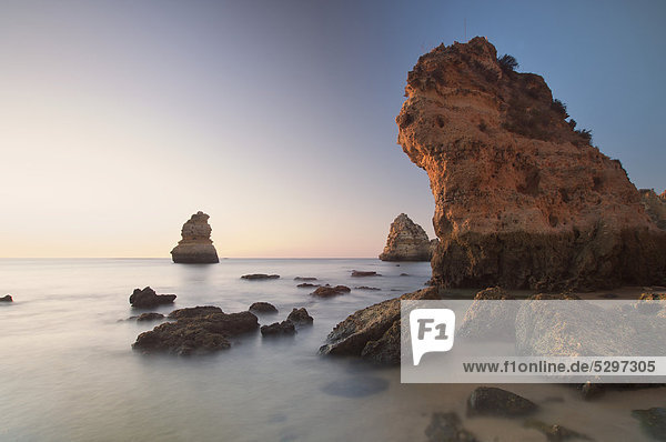 Beach with rocks at sunrise  Lagos  Portugal  Europe
