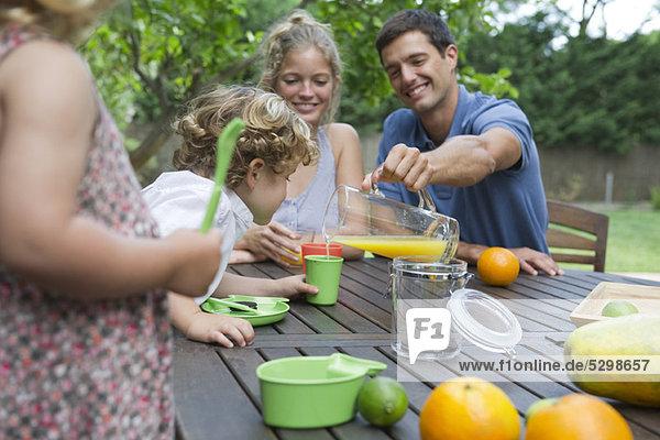 Family enjoying outdoor snack