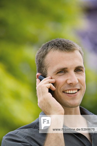 Man using cell phone outdoors