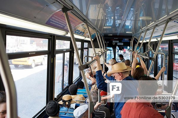 Commuters aboard a crowd New York City Transit Authority bus in New York