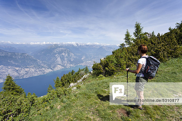 Climber while ascending Monte Altissimo above Nago  looking towards Lake Garda and Arco  Trentino  Italy  Europe