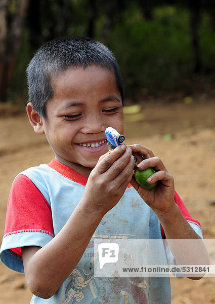 Smiling boy with a toy car in Laos  Southeast Asia  Asia