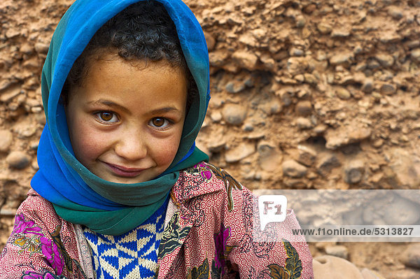Portrait of a young girl wearing a blue head scarf  nomadic cave-dweller  Berber  Dades Valley  High Atlas Mountains  southern Morocco  Morocco  Africa