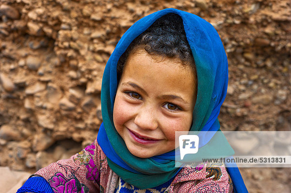 Portrait of a smiling young girl wearing a blue head scarf  nomadic cave-dweller  Berber  Dades Valley  High Atlas Mountains  southern Morocco  Morocco  Africa