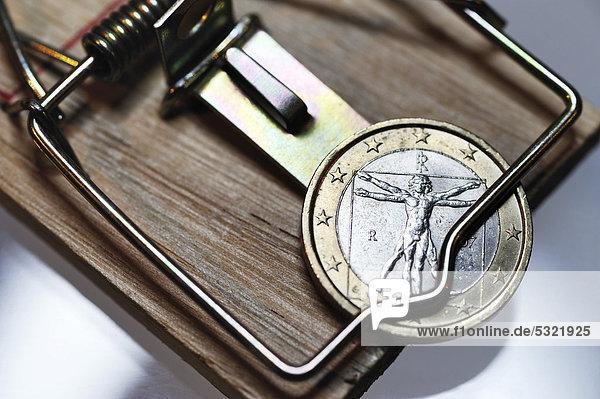 Italienische Ein-Euro-Münze in der Schuldenfalle  Symbolbild