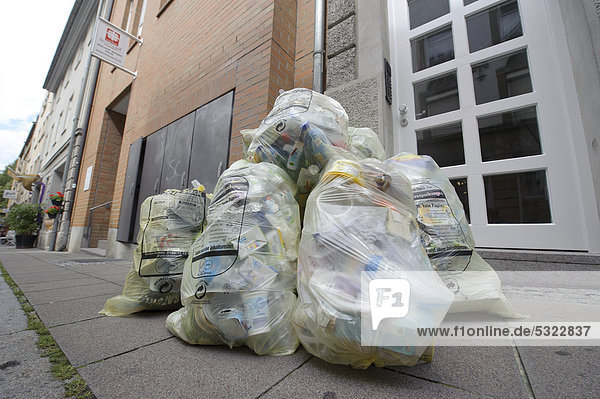 Yellow bags before collection by the garbage collection  Brennerstrasse  Stuttgart  Baden-Wuerttemberg  Germany  Europe