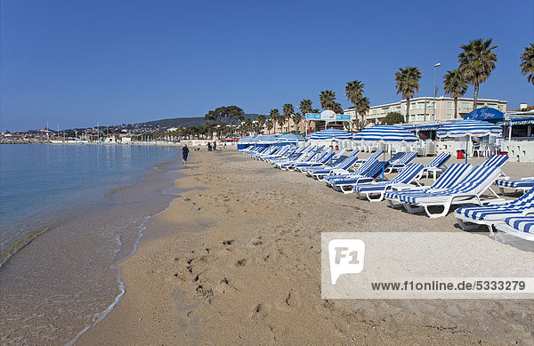 Beach chairs and sunshades on the beach of La Ciotat  Bouches-du-Rhone department  French Riviera  Southern France  France  Europe