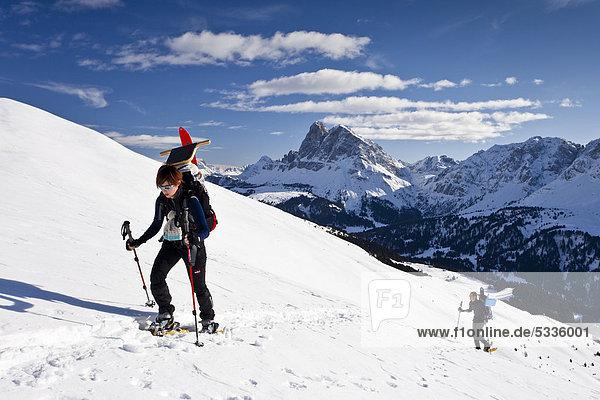 Snowshoe hikers climbing Gabler mountain  Plose mountain  Dolomites  Peitlerkofel mountain at the back  province of Bolzano-Bozen  Italy  Europe