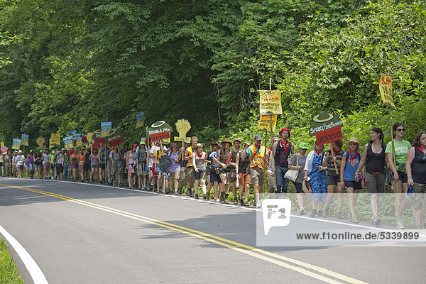 Hundreds of people marched 50 miles through the West Virginia coal fields to Blair Mountain in opposition to the coal-mining technique known as mountaintop removal  Blair  West Virginia  USA