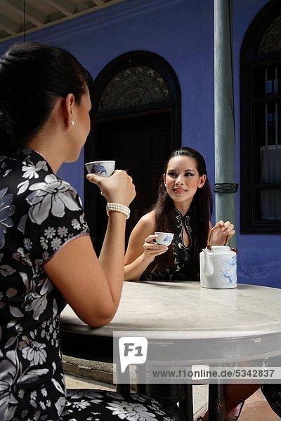 Women having Chinese tea at Cheong Fatt Tze Mansion in Penang  Malaysia