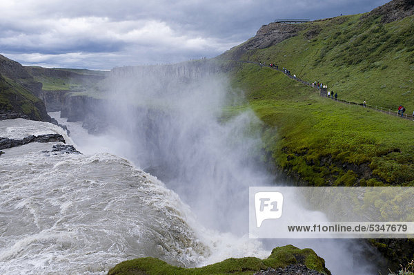 Tourists at the Gullfoss waterfall  Iceland  Europe