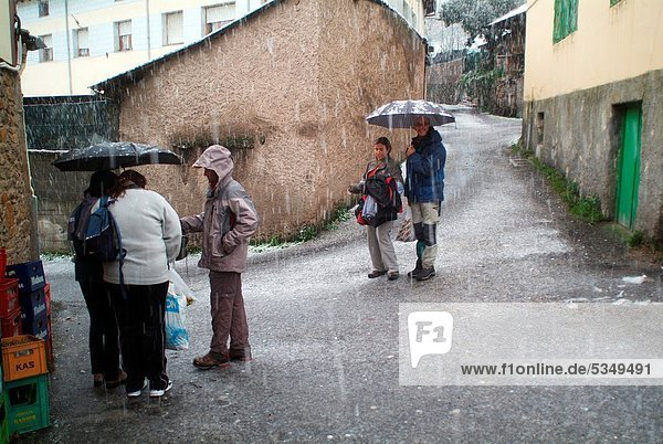 People under the rain  Cangas del Narcea  Asturias  Spain