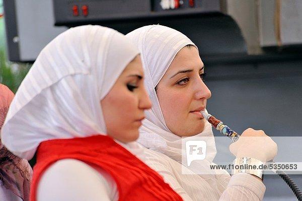 Women smoking hookah narghile´ in Aleppo Syria.