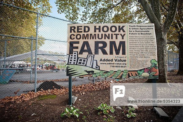 A sign at the entrance to the Red Hook Community Farm in Brooklyn in New York The farm is located on a city block in the Red Hook neighborhood formerly occupied by a disused New York City Parks and Recreation playground covering 2 75 acres The farm grows. A sign at the entrance to the Red Hook Community Farm in Brooklyn in New York The farm is located on a city block in the Red Hook neighborhood formerly occupied by a disused New York City Parks and Recreation playground covering 2 75 acres The farm grows 12 tons of produce which is sold or donated and serves as an educational experience for local teens