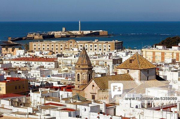 Skyline Panoramic of cadiz The church of San Lorenzo In background San Sebastian´s castle Cádiz  Andalusia  Spain
