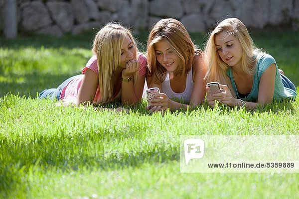 Group of Teenagers on their Blackberry´s
