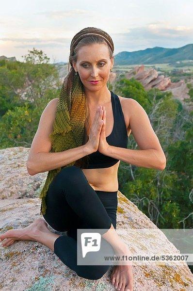 Woman doing yoga  South Valley Park  Littleton  Colorado USA