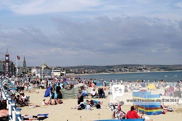 Sunbathers at Weymouth Beach Dorset