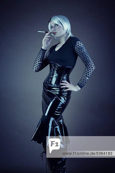 Woman  Gothic  smoking blonde  vinyl dress