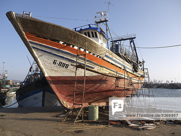 Wooden fishing boat at a shipyard in the port of Essaouira  Morocco  North Africa  Africa