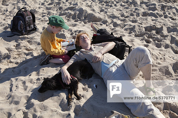 Mother and son on a beach  Kuehlungsborn-West  Mecklenburg-Western Pomerania  Germany  Europe