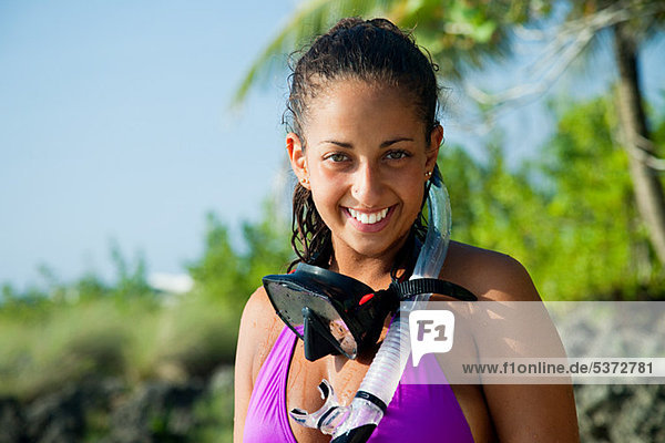 Portrait of young woman wearing diving mask  smiling