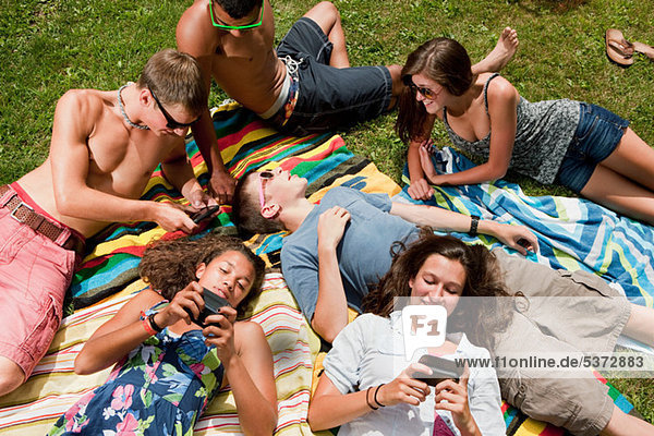 Teenagers lying down and chilling out in the countryside