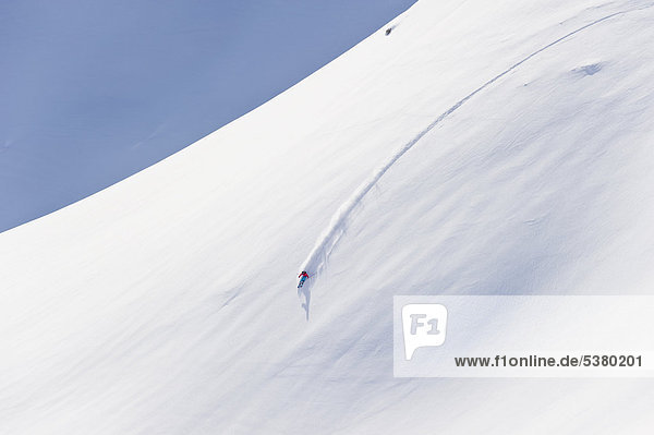 Austria  Zurs  Lech  Young woman doing alpine skiing on Arlberg mountain
