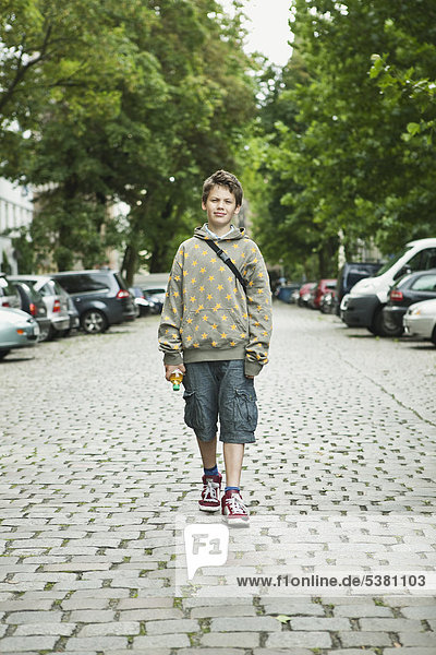 Boy standing in street