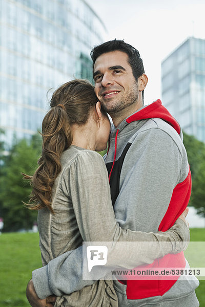 Germany  Berlin  Couple embracing in park