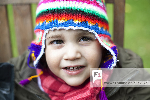 Girl wearing coat  scarf and hat