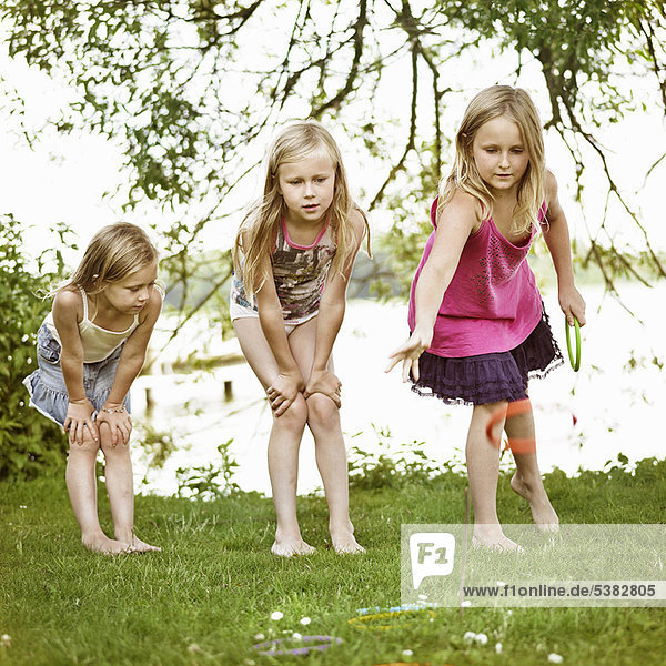 Girls playing with rings together
