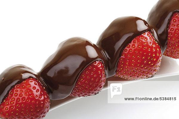Erdbeeren auf Spieß mit Schokoladenglasur