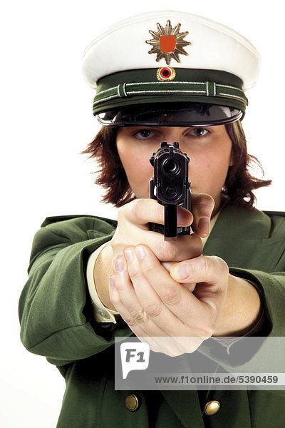 Young female police officer pointing a gun
