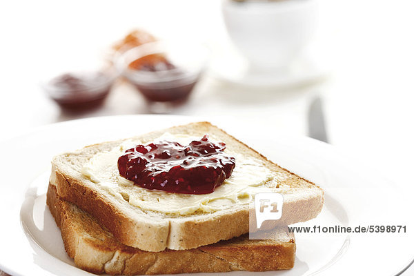 Frühstück  Toastbrot mit Butter und Marmelade Frühstück, Toastbrot mit Butter und Marmelade