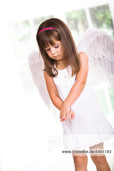 Young girl with angel wings