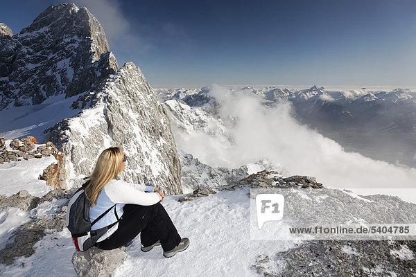 Woman enjoying the view  Dachstein Mountains as seen from Seethaler Huette mountain lodge  Ramsau  Styria  Austria  Europe