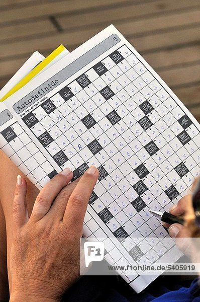 Persona doing a crossword