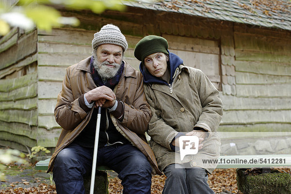 Homeless couple in front of a forest hut  wood near Carlsbad  Karlovy Vary  Czech Republic  Europe