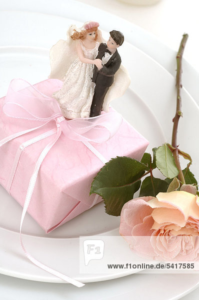 Plate with gift  rose and bride and groom figurines