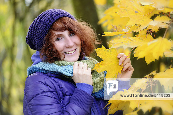 Happy woman in an autumnal environment