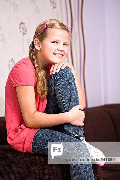 Girl  11  sitting on a sofa