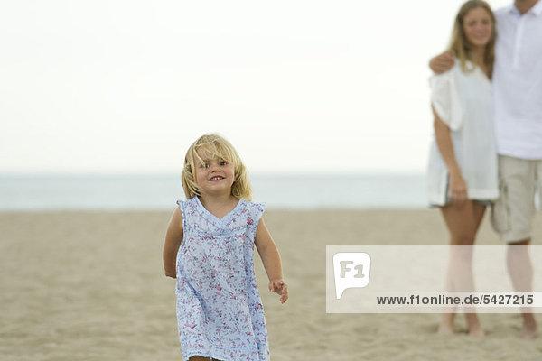 Little girl running at the beach