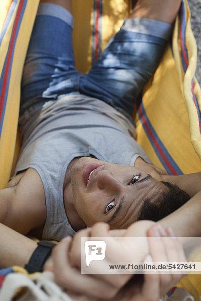 Man relaxing in hammock  portrait
