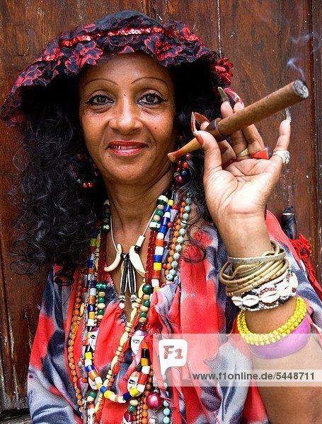Lady in Traditional dress with cigar  Old Havana  Havana  Cuba