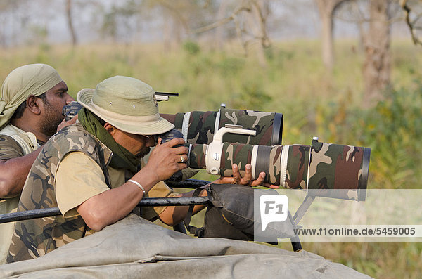 Indian wildlife photographers with telephoto lenses  Kaziranga National Park  Assam  Northeast India  India  Asia